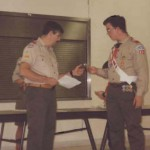 Scoutmaster Roger presenting award to famed Eagle Scout