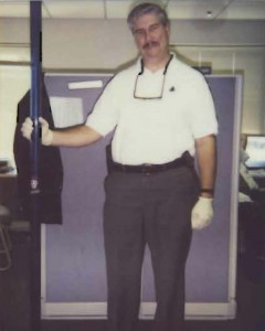 Officer Estes with a 6 foot bong during a search warrant of a house